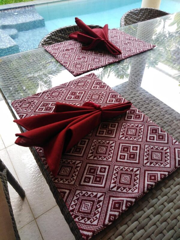 A set of 2 fabric placemats with napkins (include tassels)